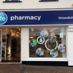 Pharmacy sign and window displays